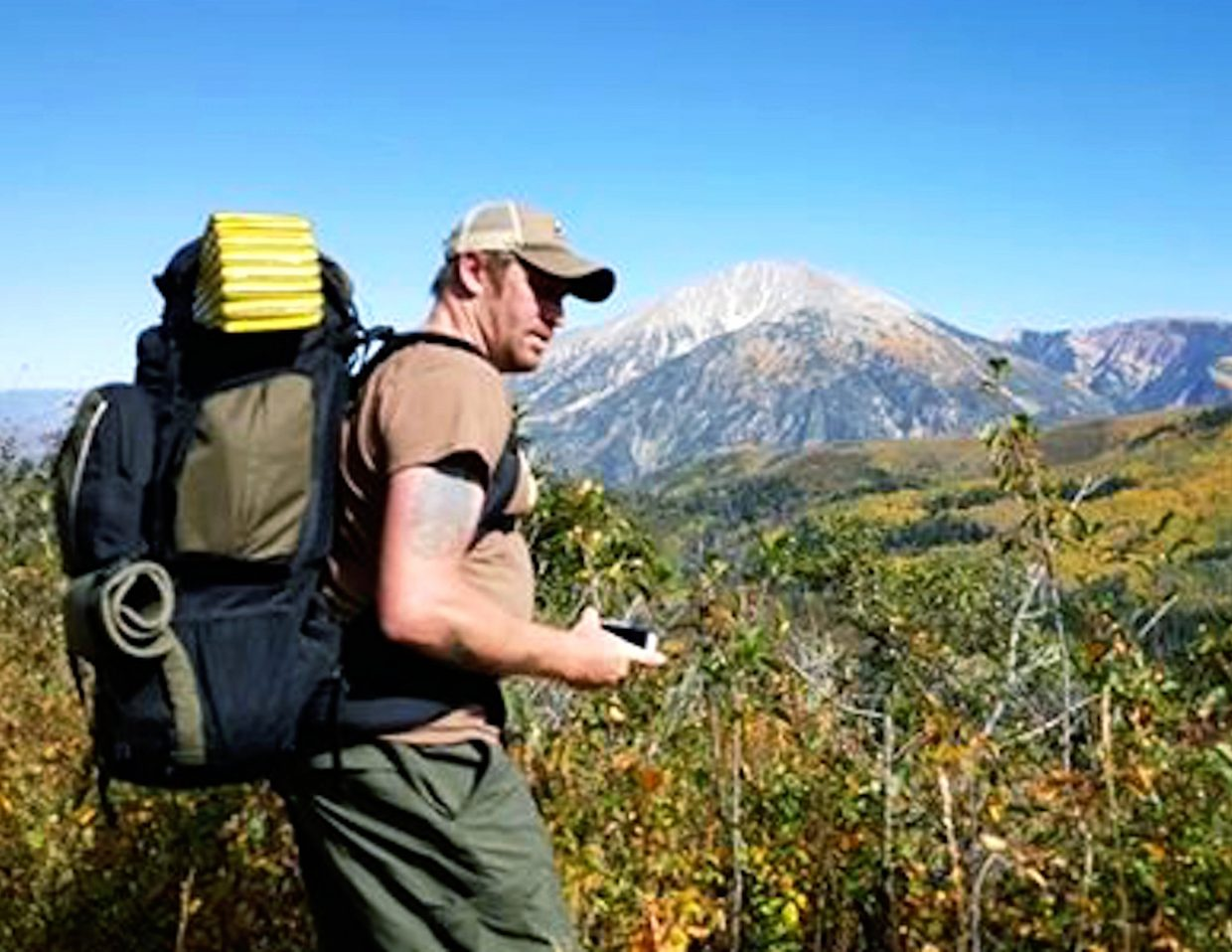 Garett Reppenhagen hikes the Lake Ridge Lakes trail with Mount Sopris in the distance.