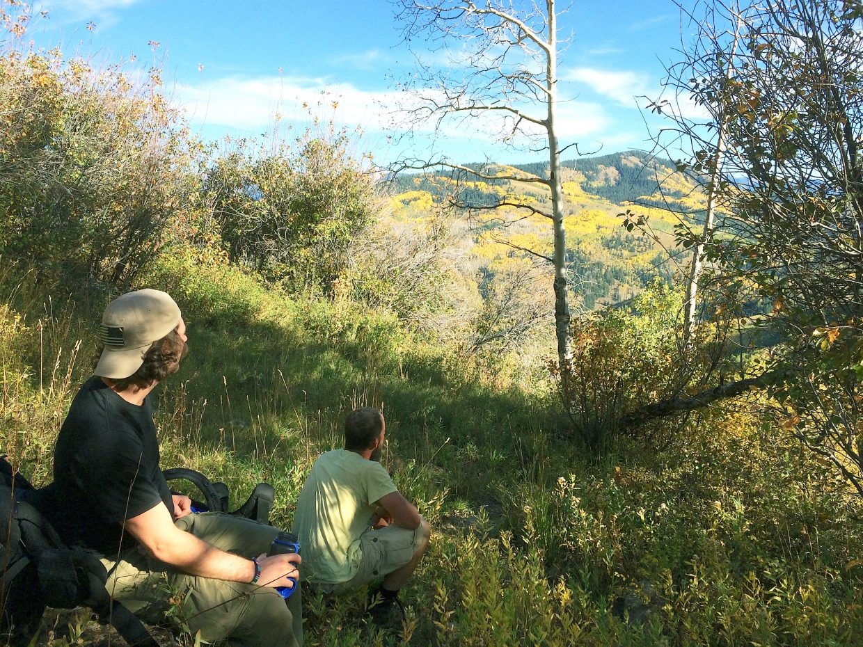 Participants in the weekend outing into the Thompson Divide area west of Carbondale, Brian Huston, left, and Grant Wideman, take a moment to take in the fall colors.
