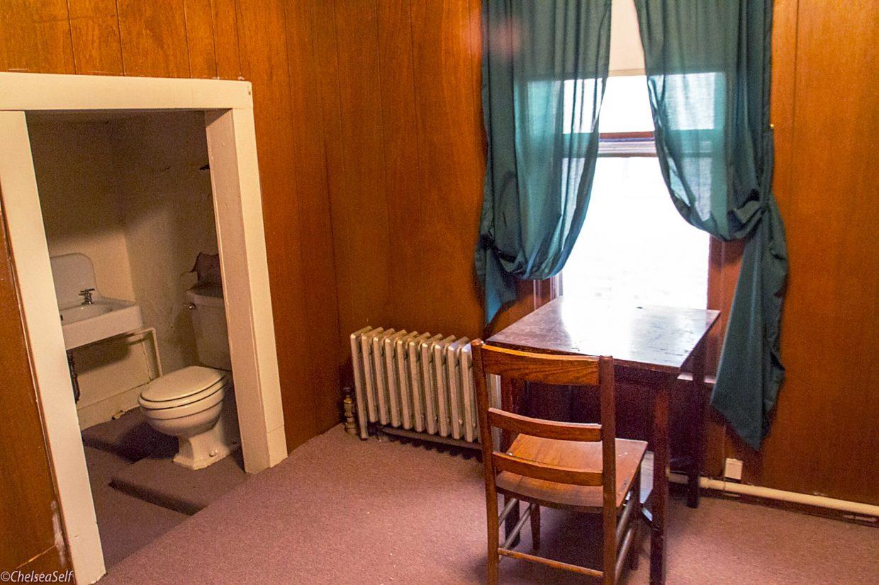 One of the empty rooms, including a makeshift step-down bathroom, in the old Western Hotel. Some rooms were rented out as apartments until 2012.