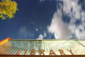 Christopher Mullen Post Independent Clouds soar over the new Carbondale Branch Library's sign,the evening before its grand opening on July 20th.