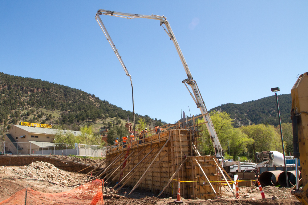 The process of pouring 226 cubic yards of concrete to complete the north Grand Avenue bridge abutment started Tuesday morning. This is the equivalent of approximately 23 trucks worth of concrete. An abutment is a structure located at the end of each bridge