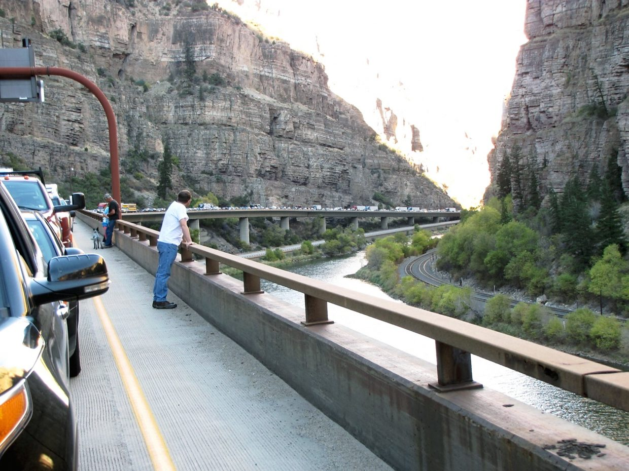 Traffic backs up in westbound lanes of Interstate 70 on Saturday afternoon while crews cleared a two-car accident in the Glenwood Canyon construction zone.