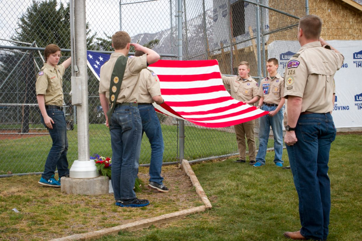 Boy Scout Troop 225 presented the American flag at the dedication ceremony for Cpl. Jesse James Beckius on Thursday afternoon. Beckius was an Eagle Scout and a Glenwood Springs native who spent two tours in Iraq with the Marine Corps. A plaque in his honor was unveiled at the Glenwood Springs Middle School baseball field; Glenwood Springs Eagle Scout Alphonse Fischer came up with the idea and raised the funds for the new flagpole.
