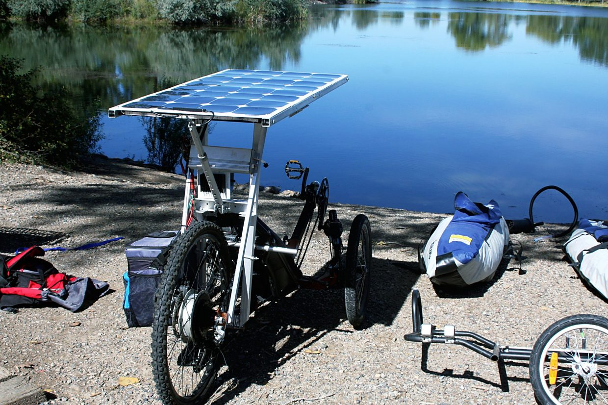 The trailer can be detached and is used as the base for the boat structure on which the bike sits.