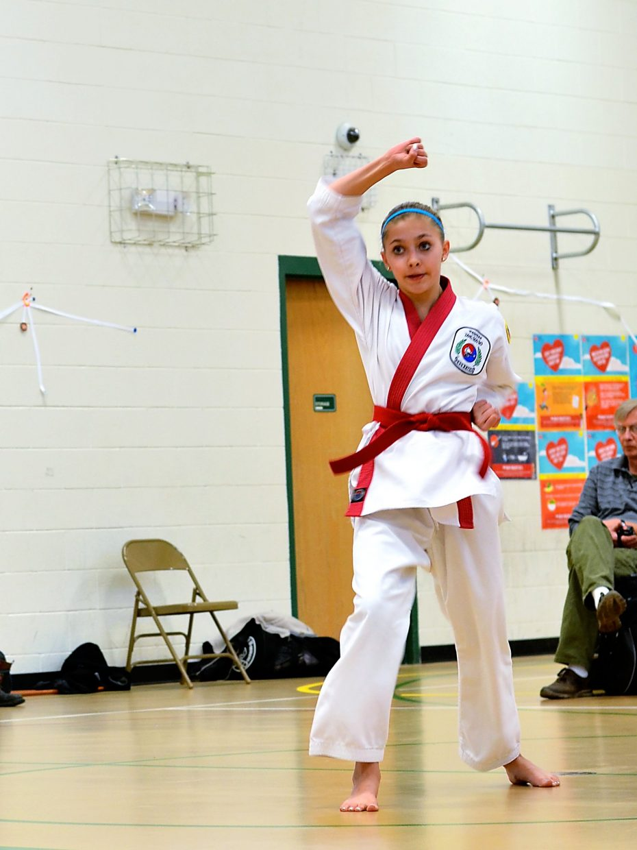 Thirteen year old Kayle Justice takes her black belt test on Saturday morning at Sopris Elementary School.