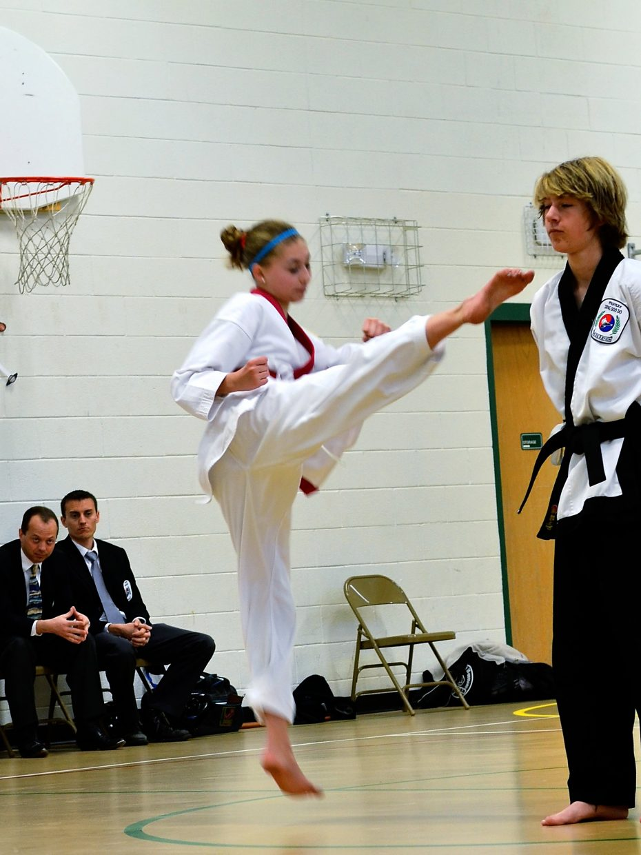 Thirteen year old  Justice takes her black belt test on Saturday morning at Sopris Elementary School.