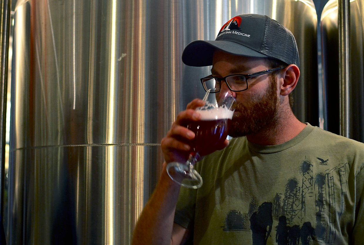 Carbondale's Matt Barrett takes a sip of Berliner Weiss, minus the syrup.