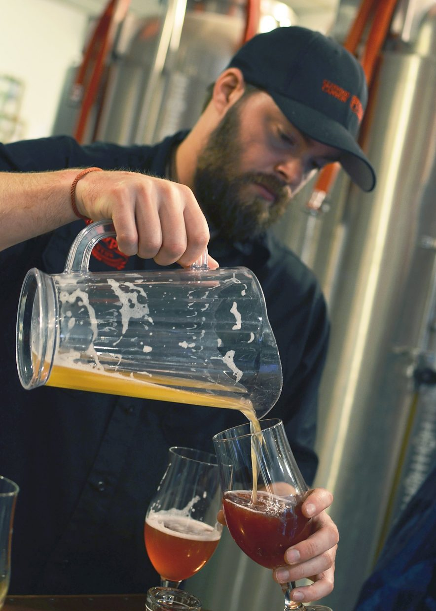 Brewer Cody Nelson mixes the Glenwood Canyon Brewpub's new sour beer with a traditional European syrup to cut the beer's tartness.