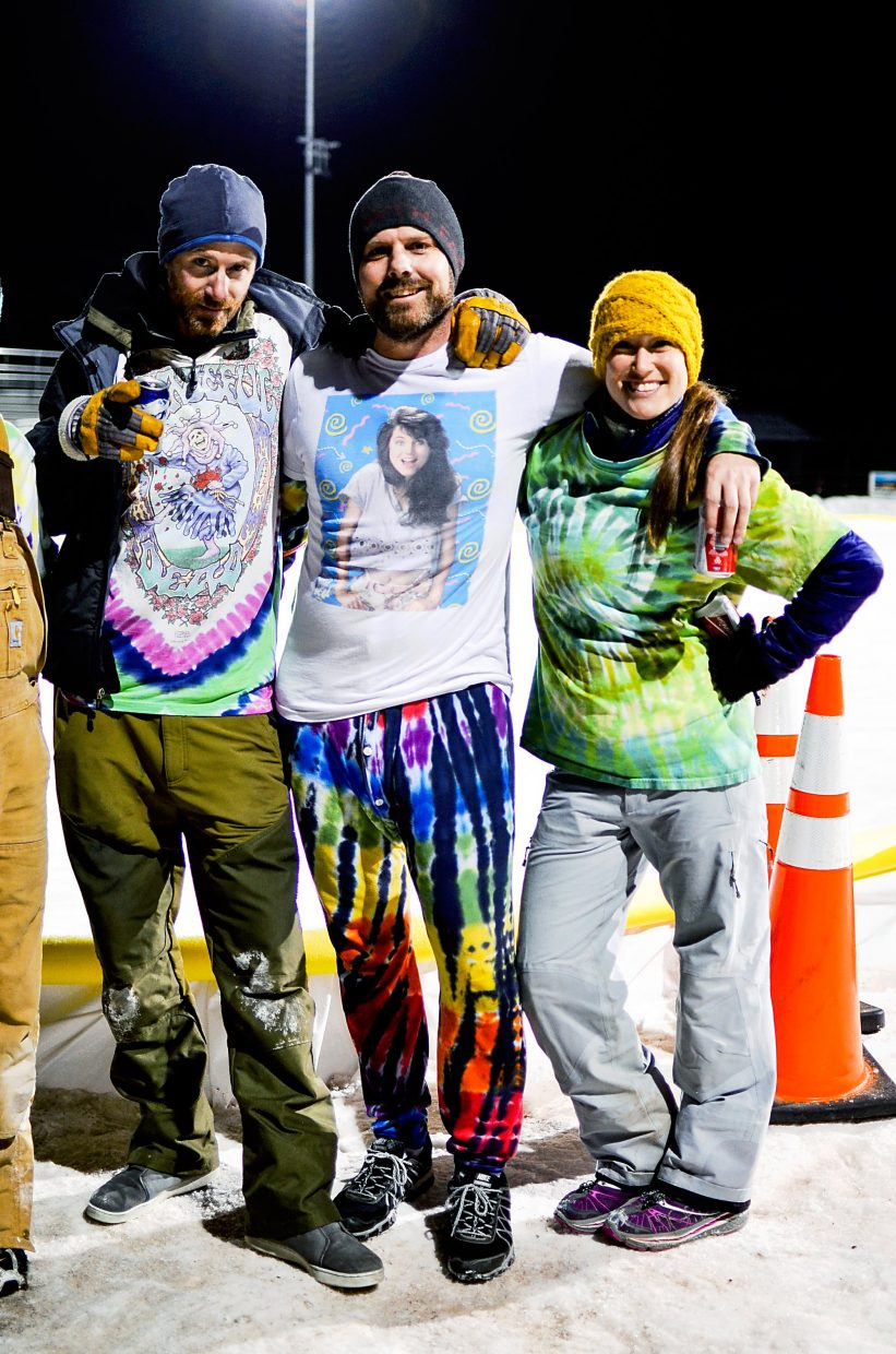 Carbondaleans Jonny Longshot, Mak Keeling and Raychl Powers show off their broomball uniforms at Carbondale's Gus Darien Ice Arena.