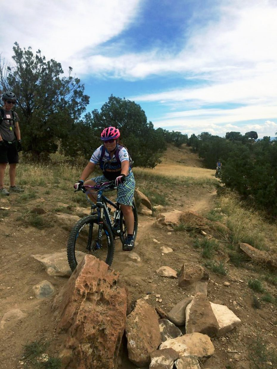 Brittany Markert, Free Press reporter, attempts a tricky spot on Prime Cut on North Fruita (18 Road) Trails. The mantra for this section was to