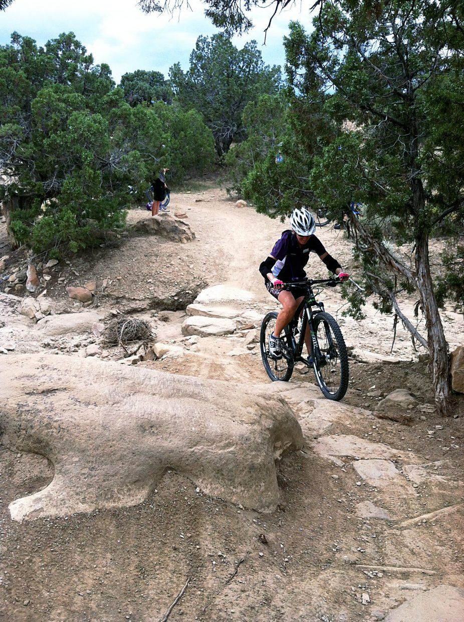 A rider uses her skills learned from the morning session on Prime Cut Trail, which included looking ahead, continue pedals, and being in the right gear.
