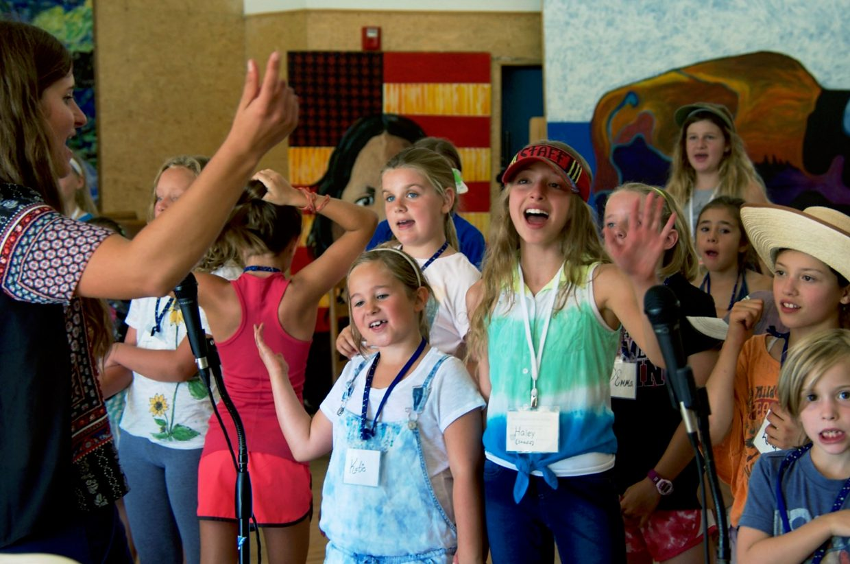 Kids sing together at the Earthbeat Music Camp, held at the Carbondale Community School.