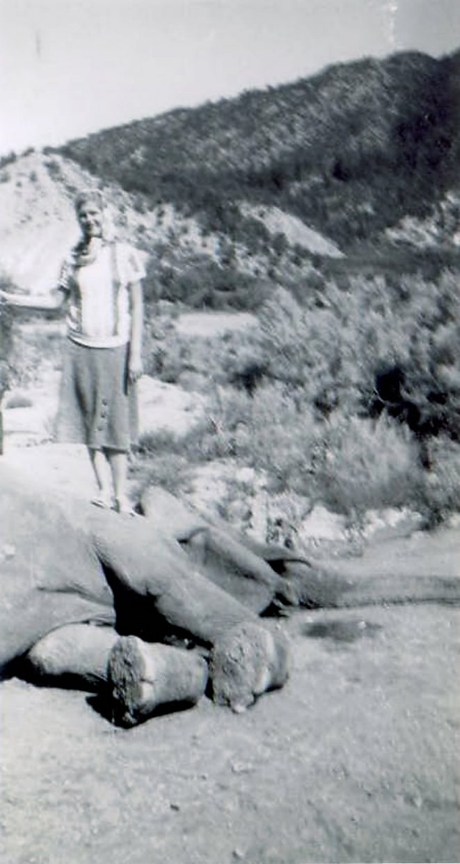 Geri Jewell standing on Bertha the elephant and holding a bb gun that's out of picture.
