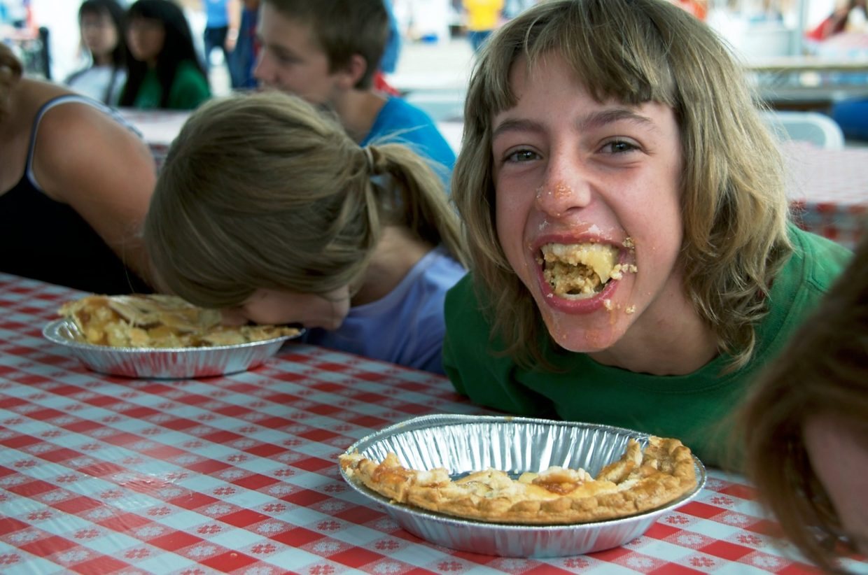 Kalyn Hurst-Farnhar, from El Jebel, does his best at the pie eating contest on Friday afternoon during the Garfield County Fair. Hurst-Farnhard didn't win, but he was definitely one of the messiest eaters.