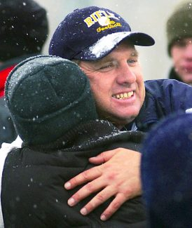 Former Rifle High School coach Darryl Gorham hugs a fan at Bears Stadium following a Rifle victory in the 2004 Class 3A state playoffs. Gorham, who followed his stint in Rifle with a nine-year coaching stint at Class 5A Highlands Ranch, has been hired as the tight ends coach at Division II Colorado State University-Pueblo.