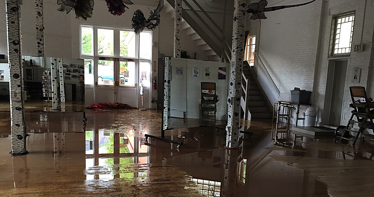 The Glenwood Springs Center for the Arts is working with a private restoration company and the city to help clean up and repair any damage from Sunday's flash flood that sent water under the center's doors.