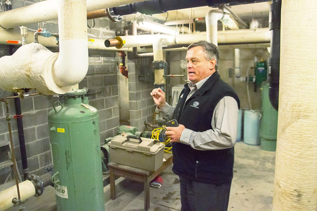 John Bosco, vice president and chief operating and financial officer for the Glenwood Hot Springs Lodge and Pool, explains the inner workings of the lodge building's geothermal heating system.