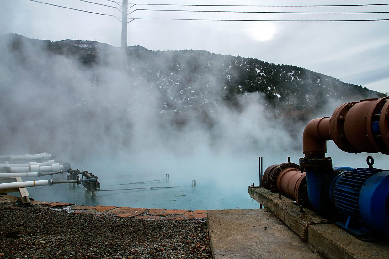 Steam rises from the main Yampa Hot Springs pool.