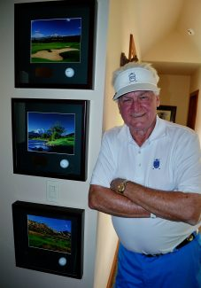 Tom Carnish stands next to three of his hole-in-one golf balls at his home in Aspen Glen. Carnish netted his eighth ace on May 19 and his sixth at Aspen Glen Golf Club, which is more than anyone else at the course.