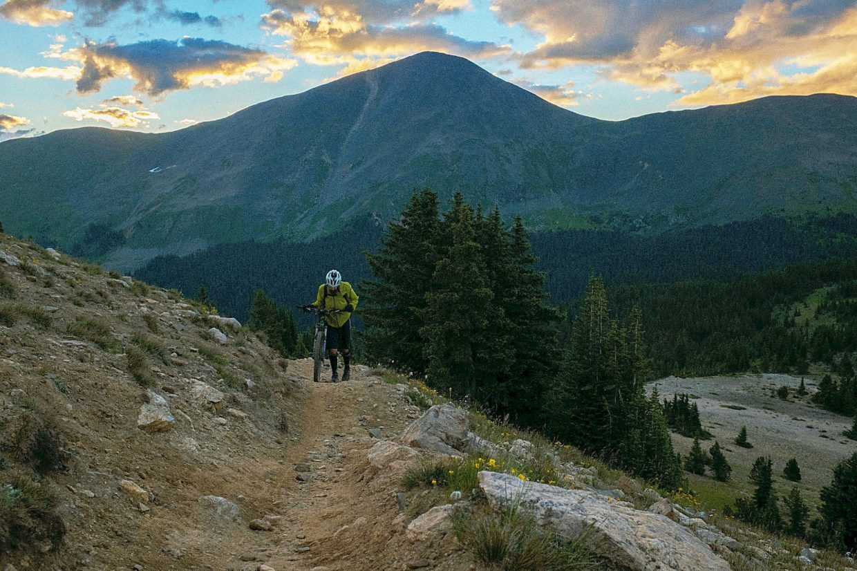 A rider pushes his bike up yet another pass on the Colorado Trail.