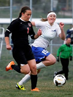 Lauren Paskett (1) of Grand Valley races down the field as Brittany Young of Coal Ridge (15) attempts to steal the ball during Tuesday afternoon's Clas 3A Western Slope League match at The Pasture. Coal Ridge went onto win, 3-1, over Grand Valley.