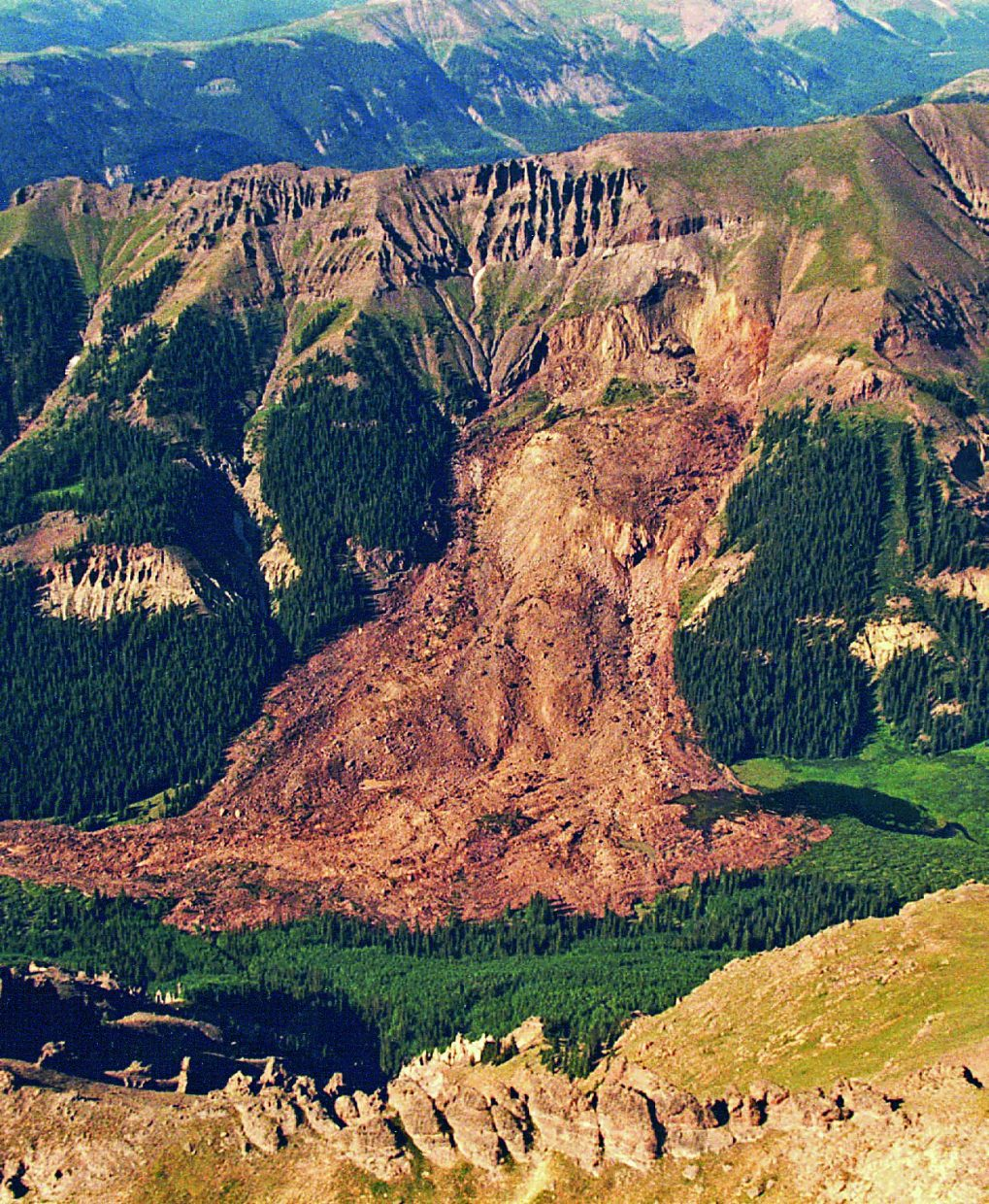 Approximately 10.5 million cubic yards of material moved in 1991 when heavy rains and meltwater triggered a catastrophic slope failure above West Lost Creek in the San Juan Mountains. The debris ran down the hillside and up the opposite valley wall to a height of nearly 200 feet. Wiitness reports suggested that the slide moved nearly ½-mile in 30 seconds.