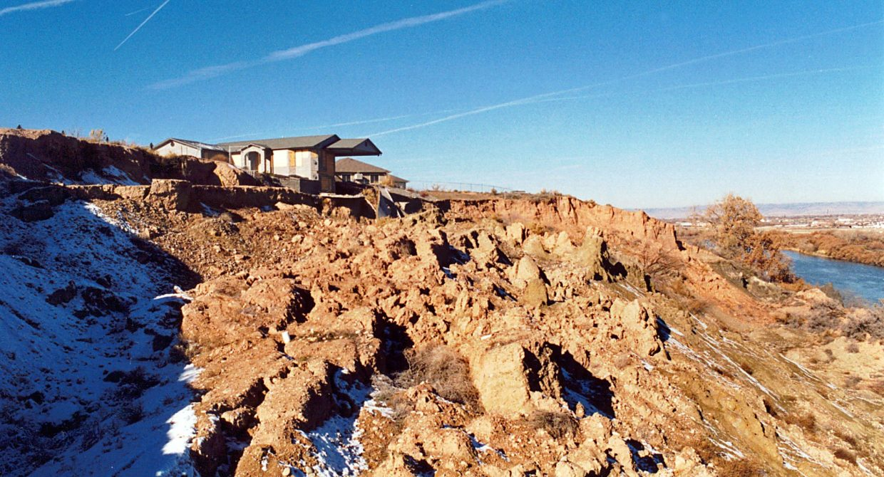 This home near Grand Junction, was destroyed by a landslide that was caused by the Colorado River undercutting its own bank.