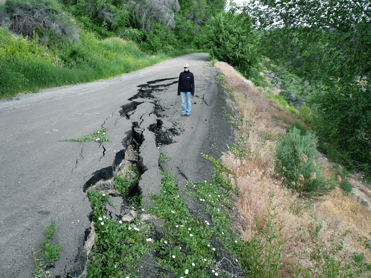 Re-activation of an old rotational landslide in June 2007 displaced and dilated a paved road near Olathe. This type of failure is common along the edges of gravel-capped mesas that are underlain by weak shale bedrock.  Poor irrigation practices can exacerbate the problem and remobilize once quiet hillsides.