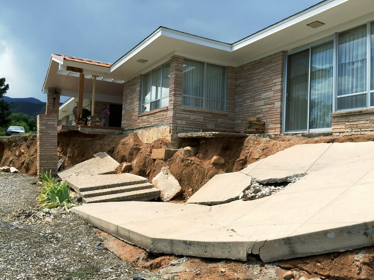 Following heavy rains in the spring of 2015, several landslides occurred that affected homes in Colorado Springs. The landslide is considered a reactivation of an ancient slide. The headscarp presently terminates along the foundation wall of the house at the top of the hill. The landslide continues to move and affects houses in the area below.