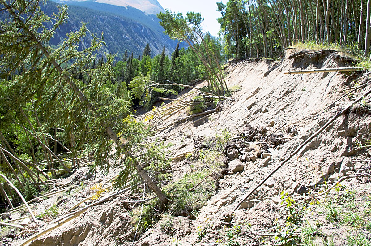 This is a portion of the headscarp of a catastrophic landslide that destroyed Huerfano County Road 580 over several days in July 2015. This slide appears to have been triggered by a breached collection ditch that drained water into the hillside over several years.