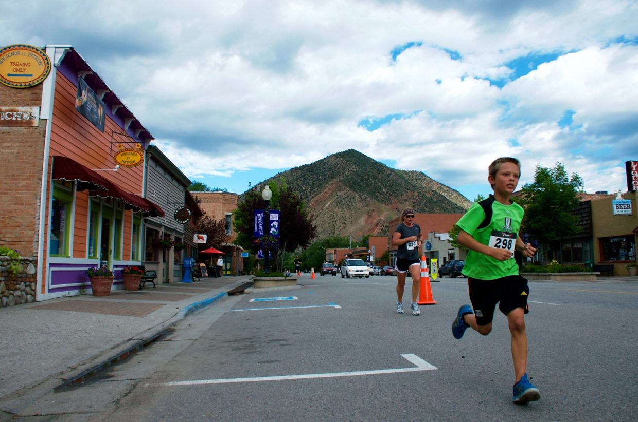 Runners finish Saturday's Hogback Hustle 5K in New Castle.
