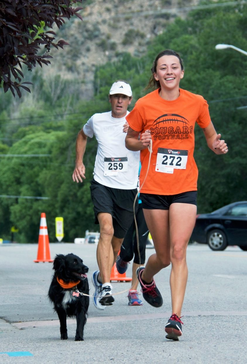 Two- and four-legged finishers at Saturday's Hogback Hustle 5K in New Castle.