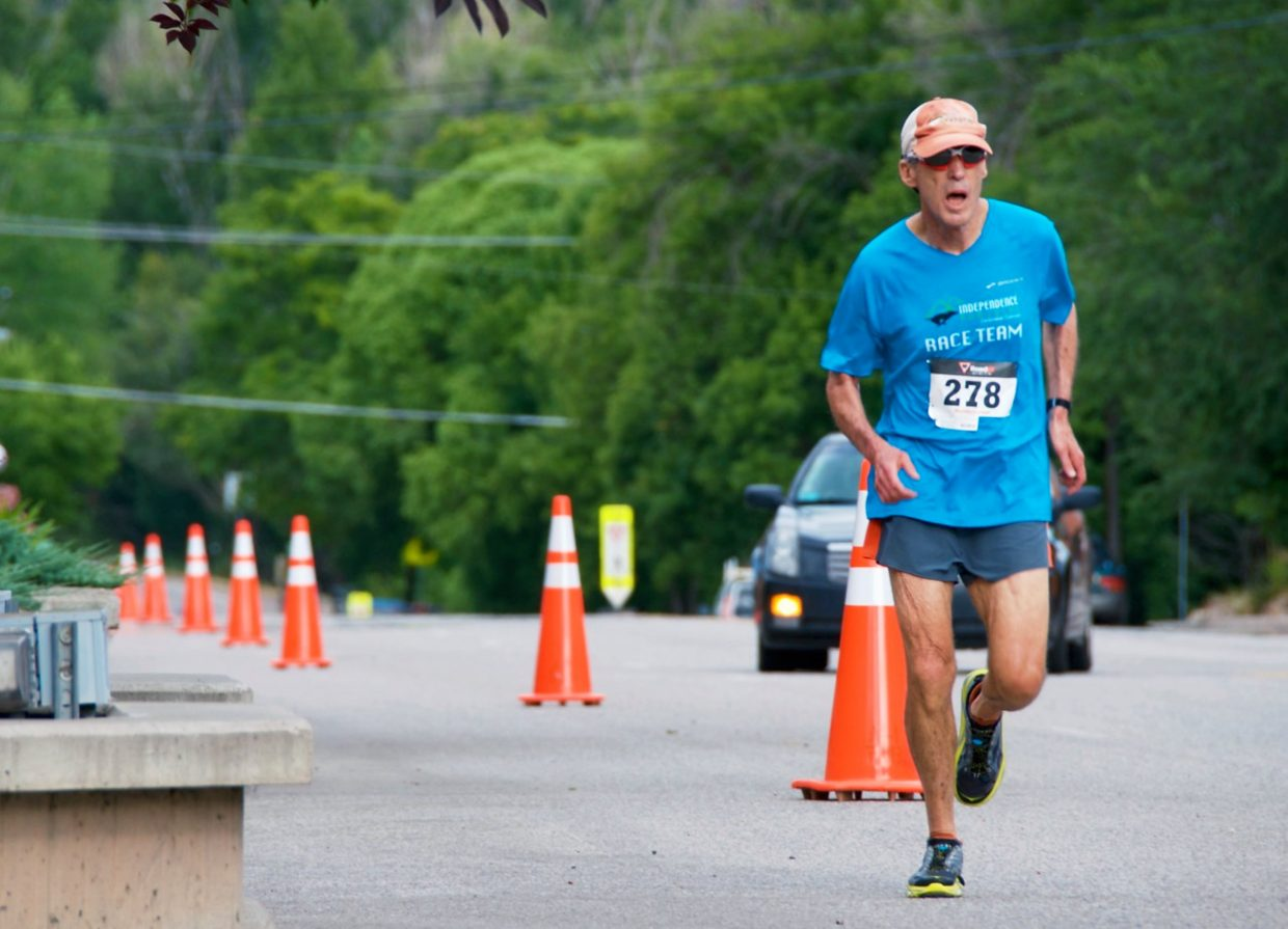 Greg Feinsinger runs down the home stretch at the Hogback Hustle 5K in New Castle on Saturday morning.
