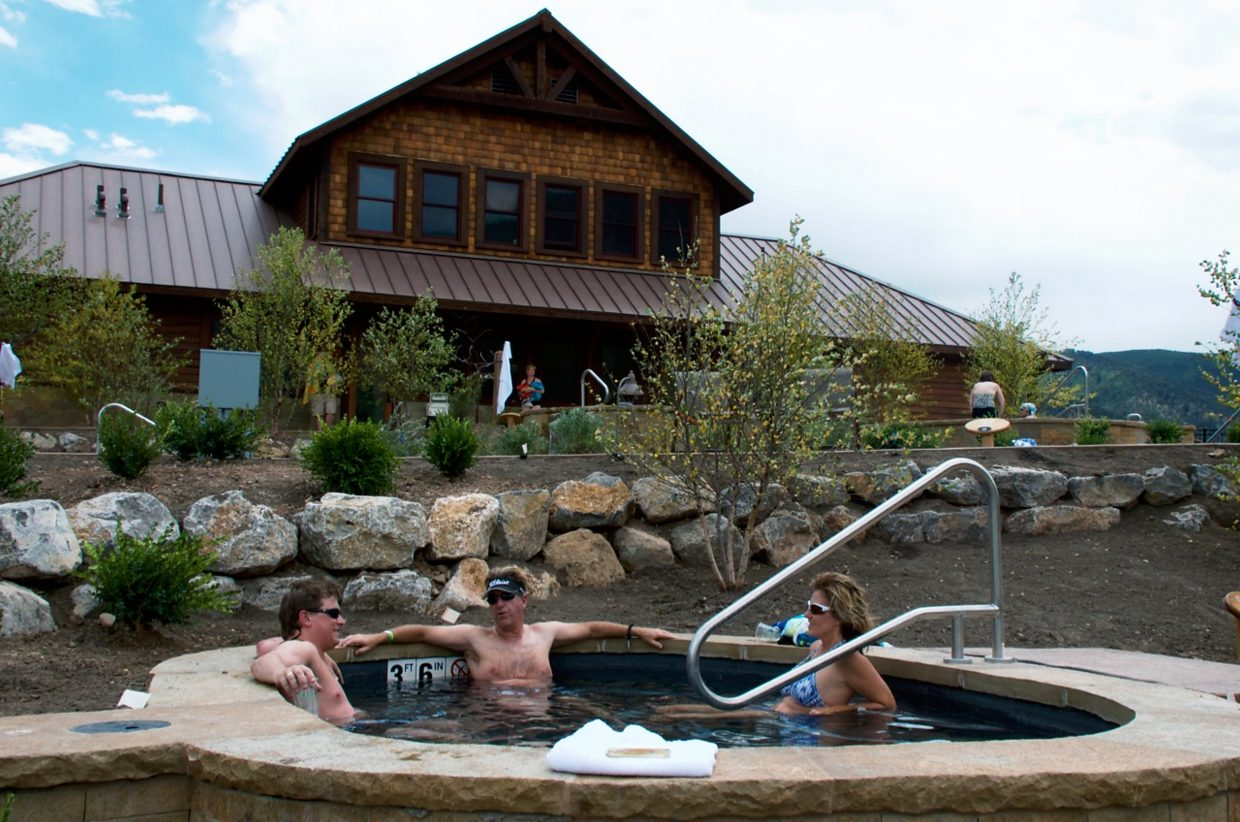 "At Iron Mountain Hot Springs' soft opening last month, 14 of the 16 pools provided peaceful relaxation to the 117 guests who had visited by noon. Soothing music played over speakers throughout the facility, and guests seemed calm and happy. Here, Kenny Greer of Denver, Lowell Keppel of Thorton and Tracie Hoffman of Westminster enjoy one of the medium-temperature pools. ""I love it,"" said Greer, who was visiting Glenwood Springs for the first time. ""It's a great spot on the river, and the drink service is awesome."""