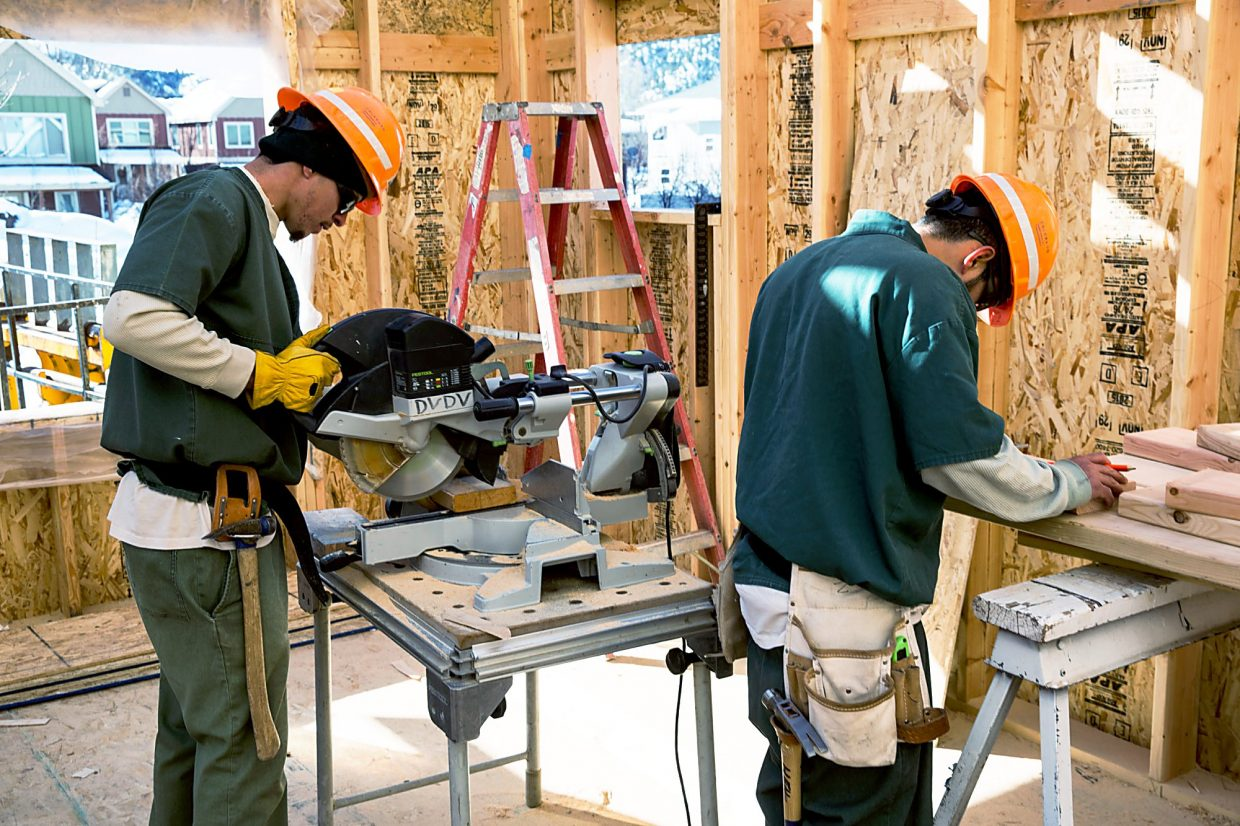 Inmates from the Rifle Correctional Center help construct a Habitat for Humanity house in Carbondale Thursday.