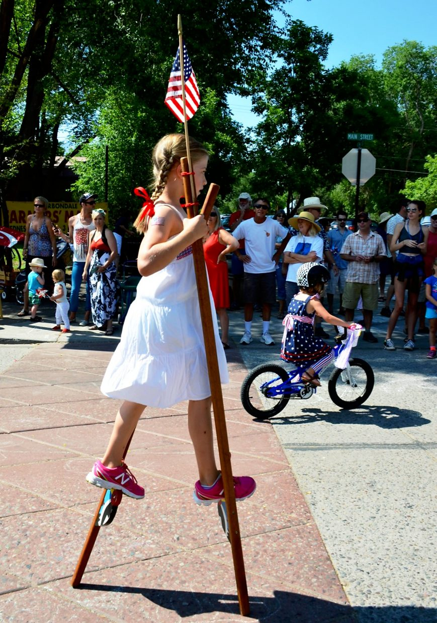 Kids and adults on bikes, rollerskates, strollers, wagons and scooters showed up with decked-out rides for the Fourth of July parade in downtown Carbondale. The patriotic procession started with firetrucks and ended with Captain America on skis.