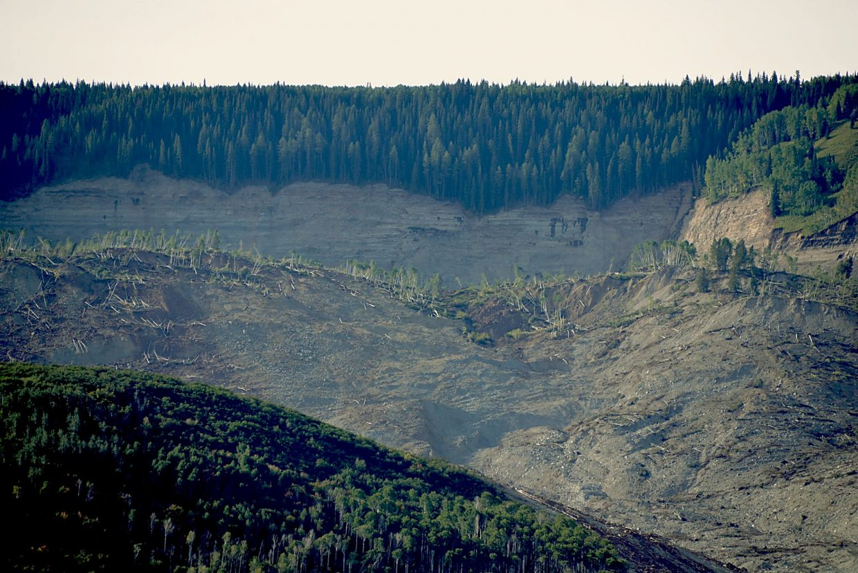 A view of the headwall in the background with the slump block falling away from the Grand Mesa. In between the two lies a 190 acre-foot lake that will likely fill to capacity and spill over in springtime, possibly draining the entire lake. The seismometer at Rapid Creek Station, part of the Colorado Mesa University Seismic Network located at various points around Grand Junction, started recording the waves of motion at exactly 5:44 p.m. May 25, 2014. It killed three Collbran residents as they were checking a clogged irrigation ditch.