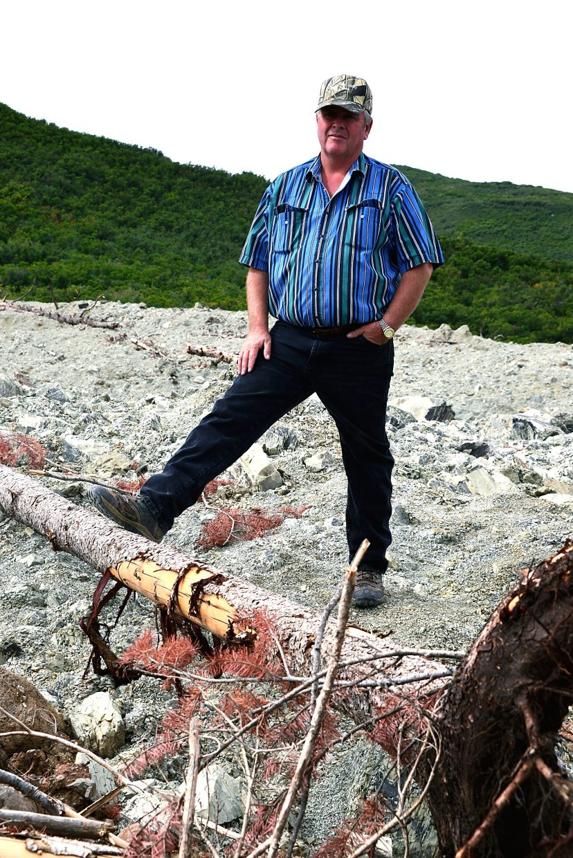 Jerald Hawkins, owner of the Hawkins Ranch, stands where the slide occurred. He explained how a way of life was swept away in a matter of minutes.