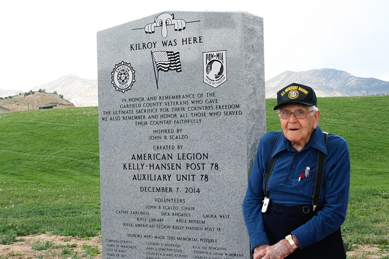 John Scalzo stands beside the most recent addition to the Western Garfield County Veterans Memorial in north Rifle May 3. The new stone lists the names of Garfield County veterans who were killed in action.