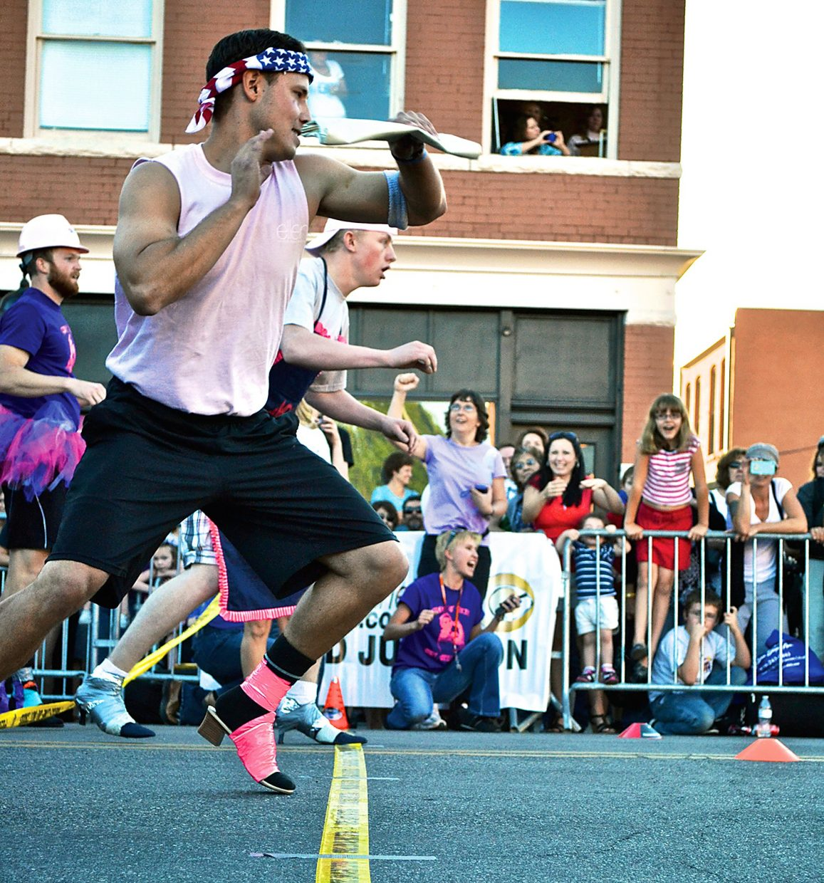 Spectators cheer on participantsat last year's Men in Heels race, which raised more than $32,000. This year event organizers hope to collect $40,000 or more.