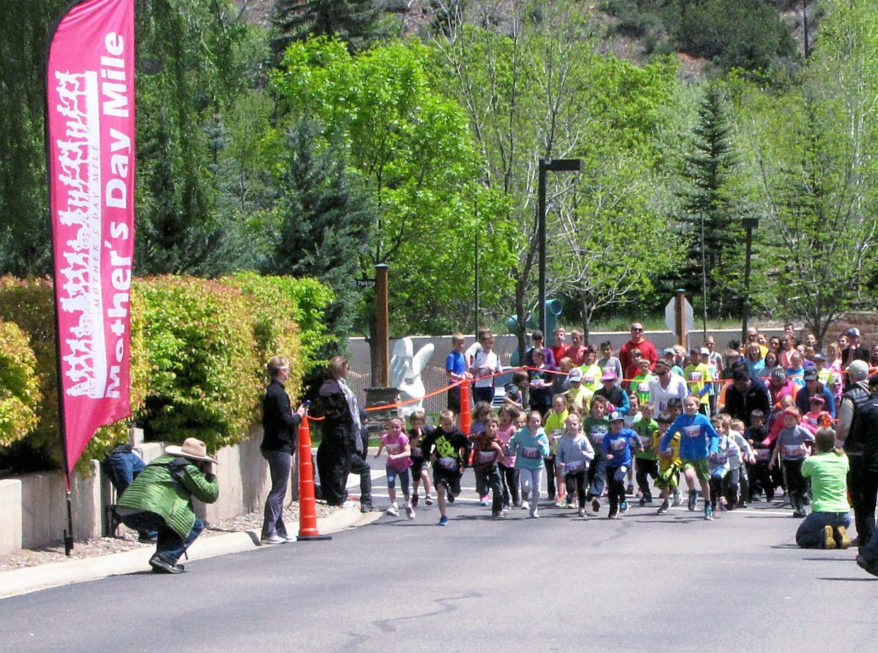 Children start in Sunday's Mother's Day Mile. Sun punched through for the race, which started and finished at Glenwood Medical Associates.