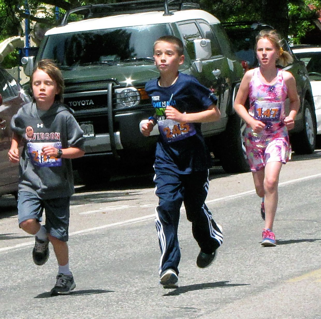 Youngsters near the finish of the Mother's Day Mile on Sunday.