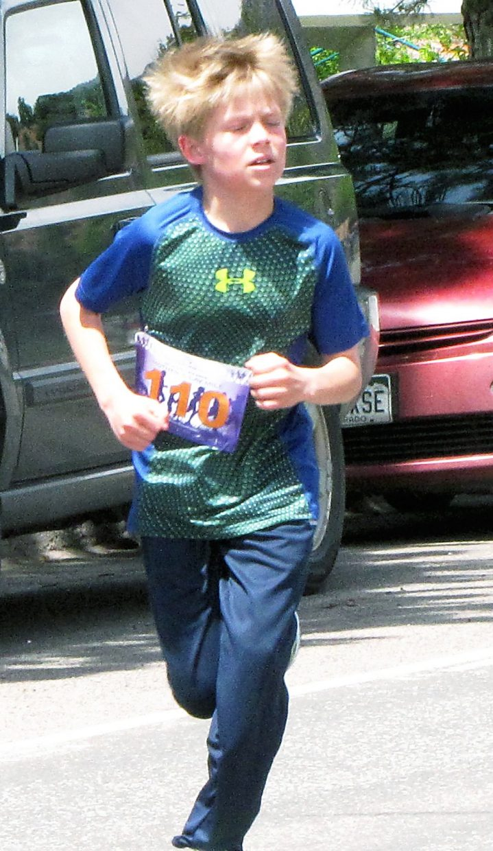 Hair flying, a young runner competes in the Mother's Day Mile on Sunday.