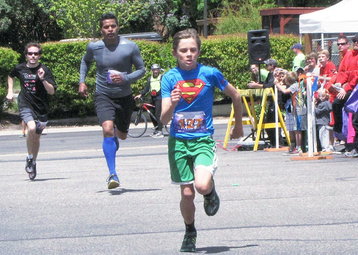 Henry Barth, 15, finishes in fourth place in 5:51 in the 15-40 division of Sunday's Mother's Day Mile.