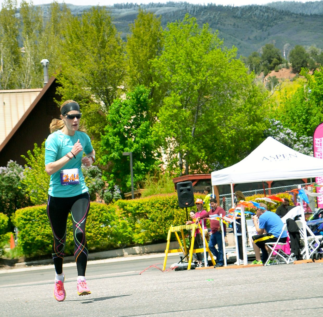 Ellen Brooks, 46. was the top female finisher in &:19 in the 40 and older division of Sunday's Mother's Day Mile.