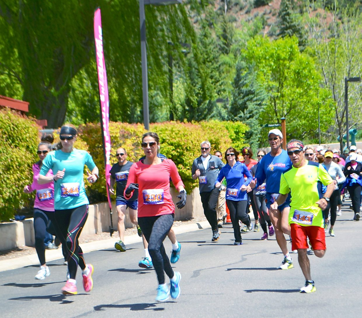 Runners take off Sunday in the Mother's Day Mile 40 and older division.