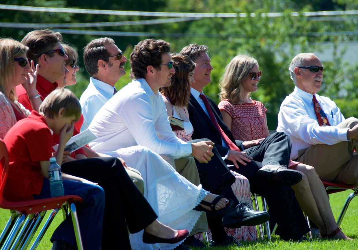 Coach Miller's family listens to a speaker at his memorial service.
