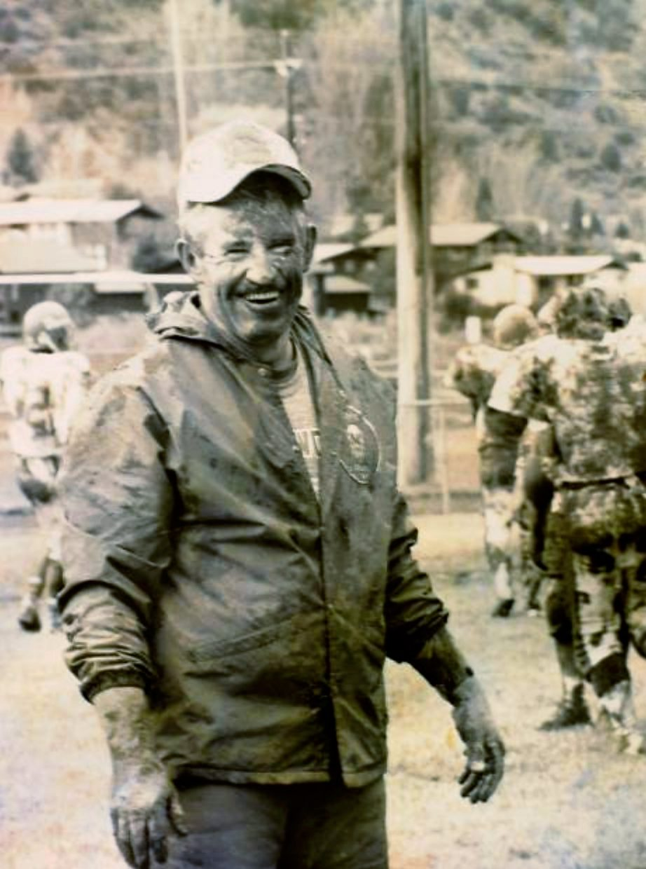 Don Miller smiles during football practice at Glenwood Springs High School after taking part in tackling drills during this 1989 file photo. Miller, who coached at Glenwood for 31 years, died on Monday, his family said. He was 79.
