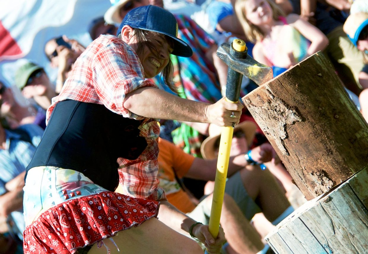 Olivia Pevec, from Carbondale, digs hard with her maul in the women's woodsplitting contest on Saturday afternoon.