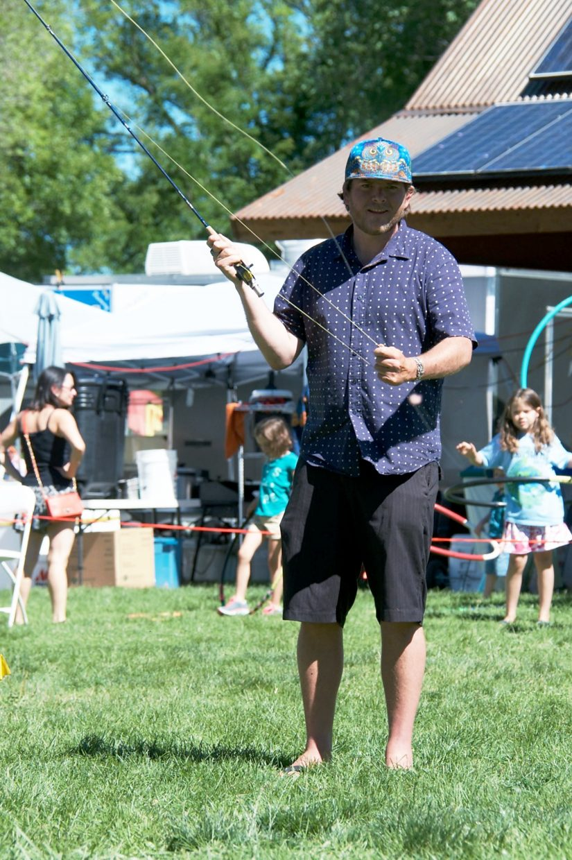 Charlie Noone, from Glenwood Springs, participates in the fly casting competition at Mountain Fair on Saturday morning.